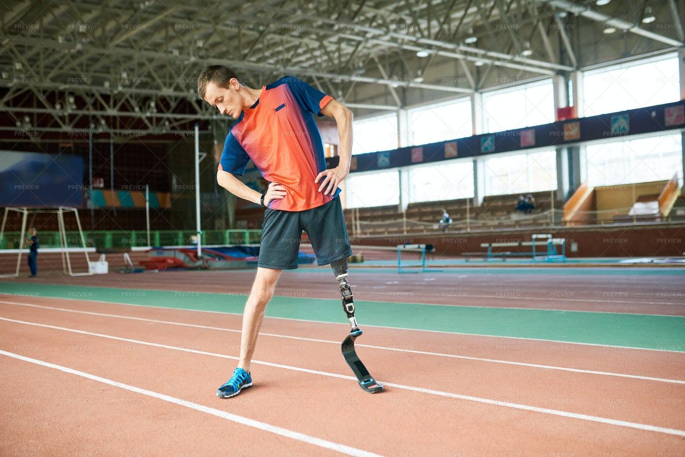 Adaptive Sportsman Warming Up: Stock Photos