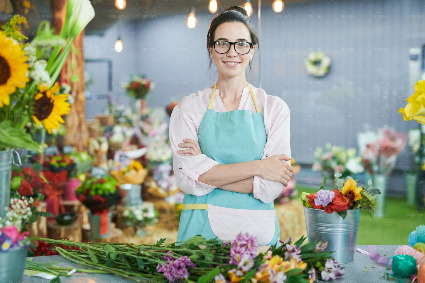 Woman Posing In Flower Shop: Stock Photos
