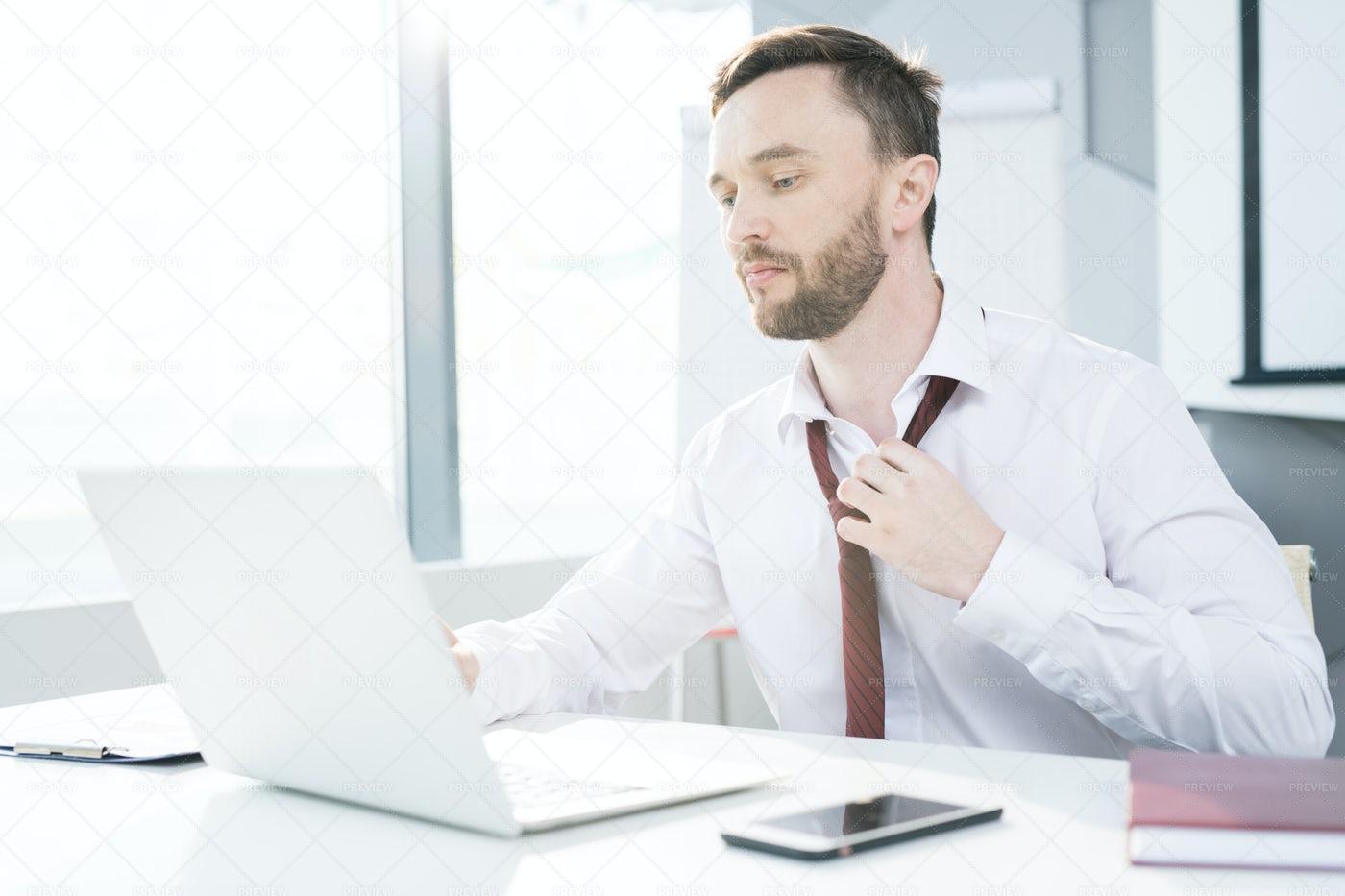 Businessman Loosening Tie: Stock Photos