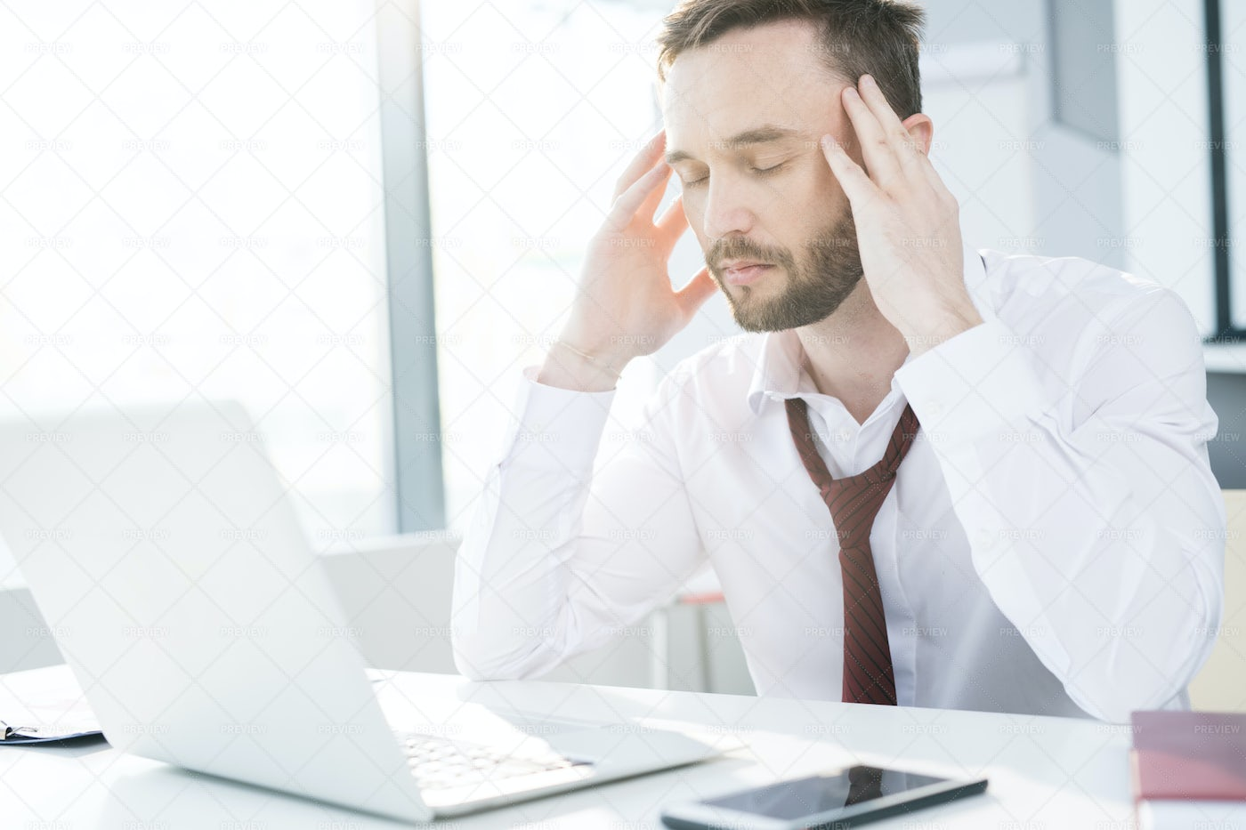 Exhausted Businessman Working: Stock Photos
