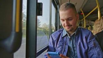 Man Using Phone On Bus: Stock Video