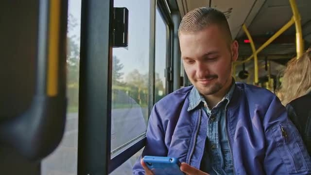 Man Using Phone On Bus: Stock Video