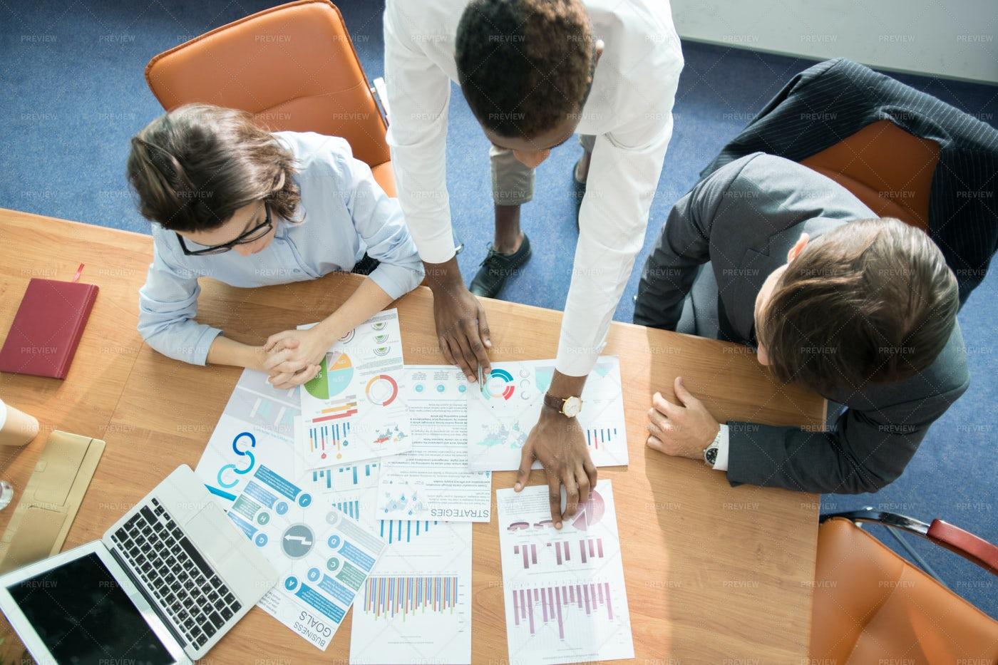 Marketing Team Analyzing Statistics...: Stock Photos