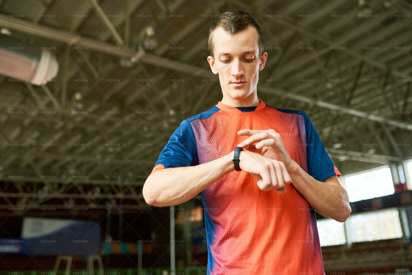 Sportsman  Checking Fitness Tracker: Stock Photos