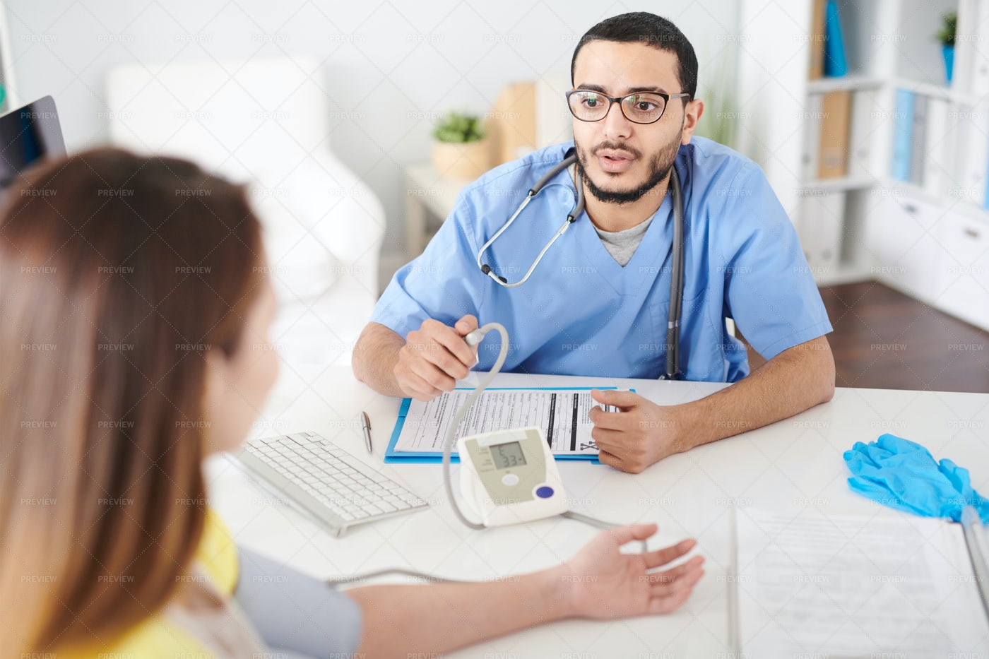 Doctor Consulting Patient In Modern...: Stock Photos