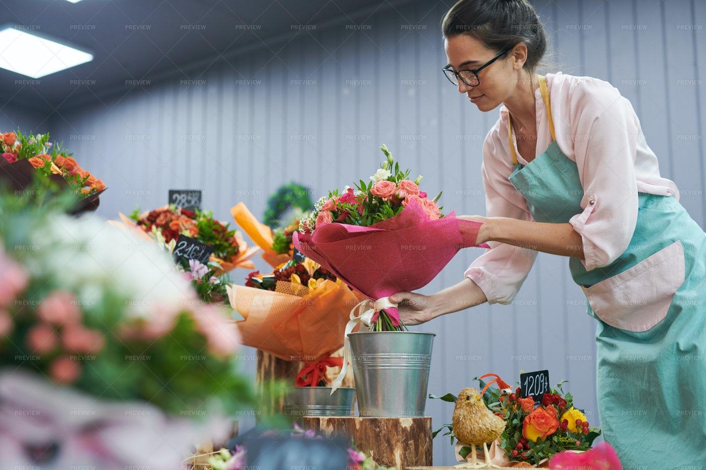 Florist Working In Shop: Stock Photos