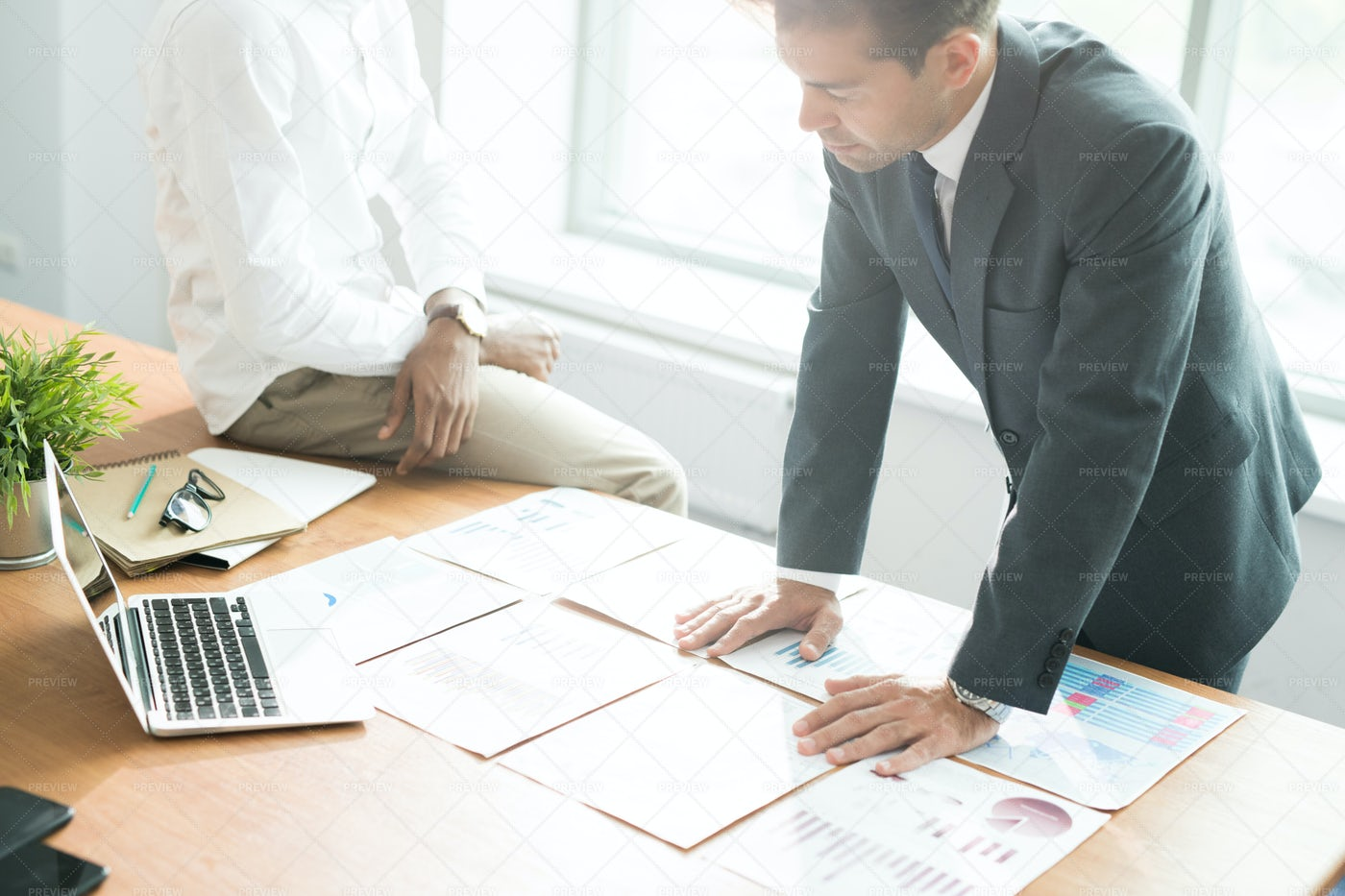 Concentrated Businessman Analyzing...: Stock Photos