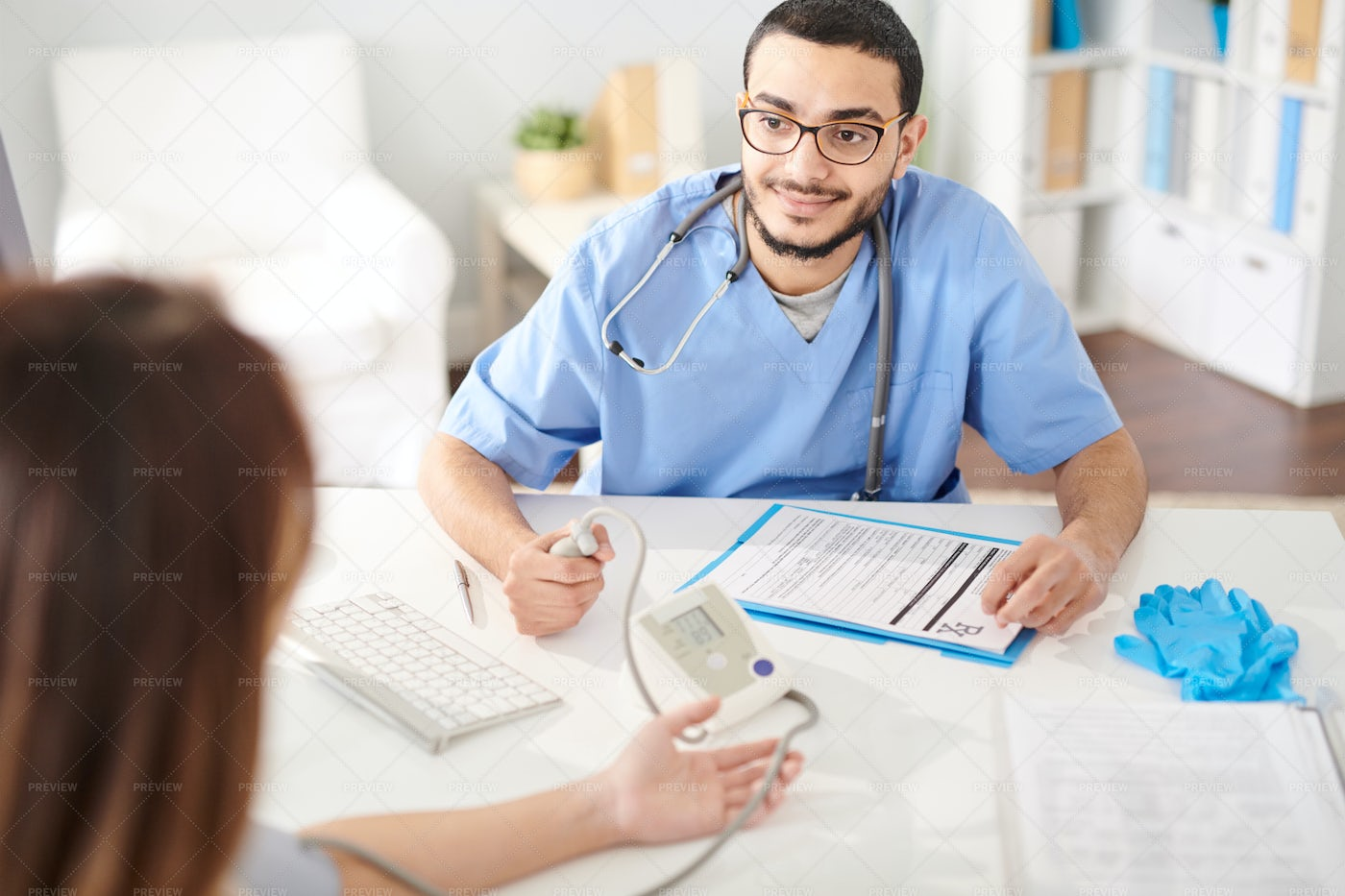 Middle-Eastern Doctor Working With...: Stock Photos