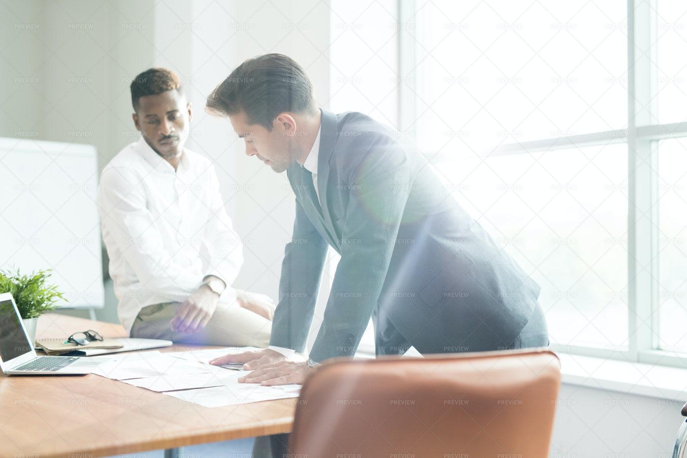Thoughtful Businessmen Examining...: Stock Photos