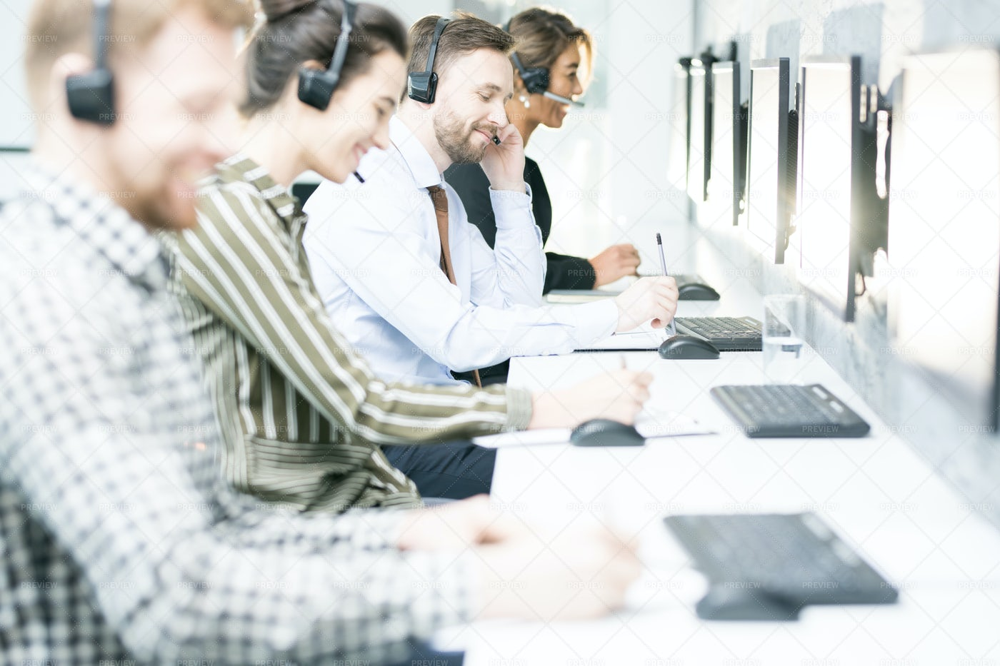 Customer Support Operators In Row: Stock Photos