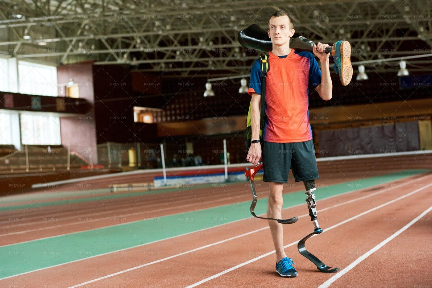 Handicapped Sportsman Holding Leg...: Stock Photos