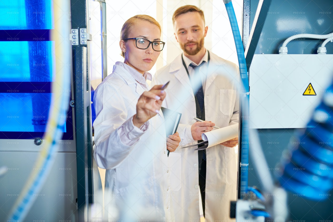 Concentrated Inspectors At Work: Stock Photos