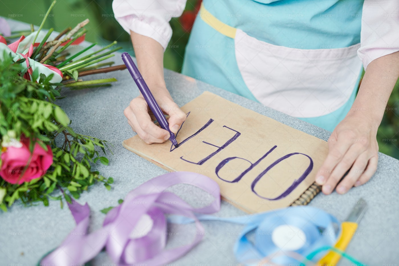 Shopkeeper Drawing OPEN Sign: Stock Photos