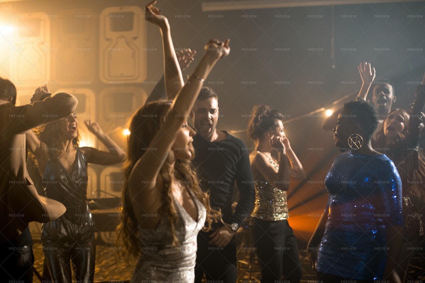 People Enjoying Nightclub Party: Stock Photos