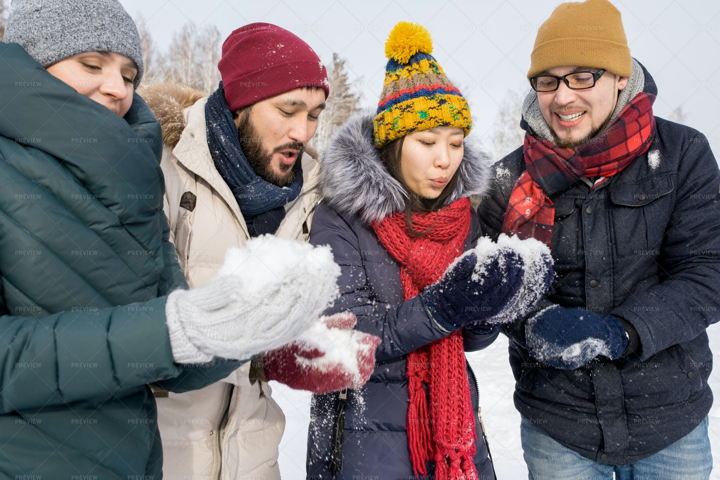 Young Friends Playing With Snow: Stock Photos
