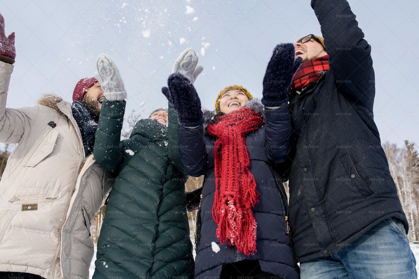 Young People Throwing Snow: Stock Photos
