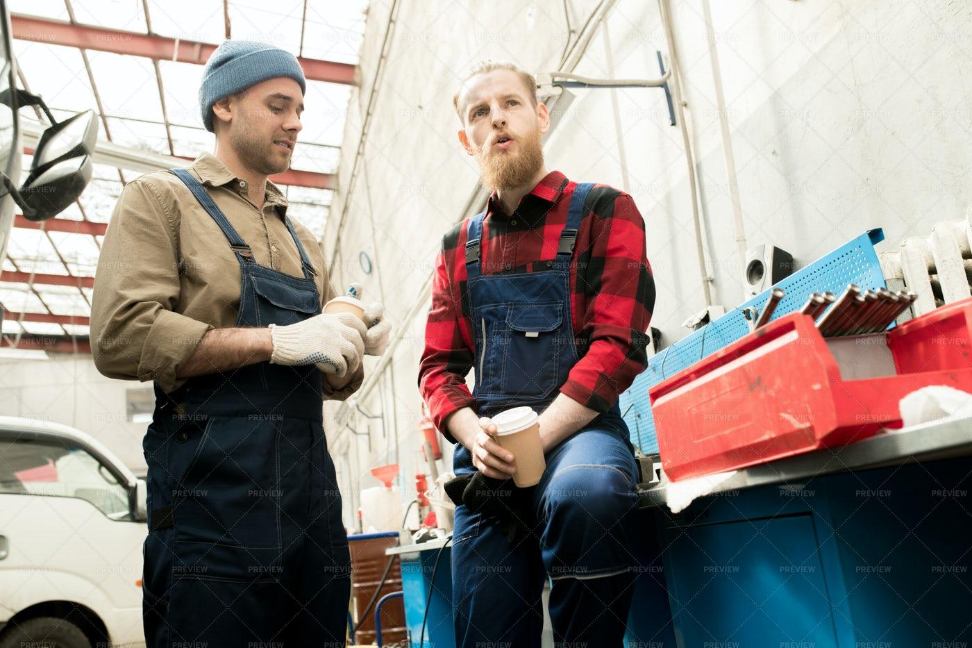 Auto Mechanics Chatting On Break: Stock Photos