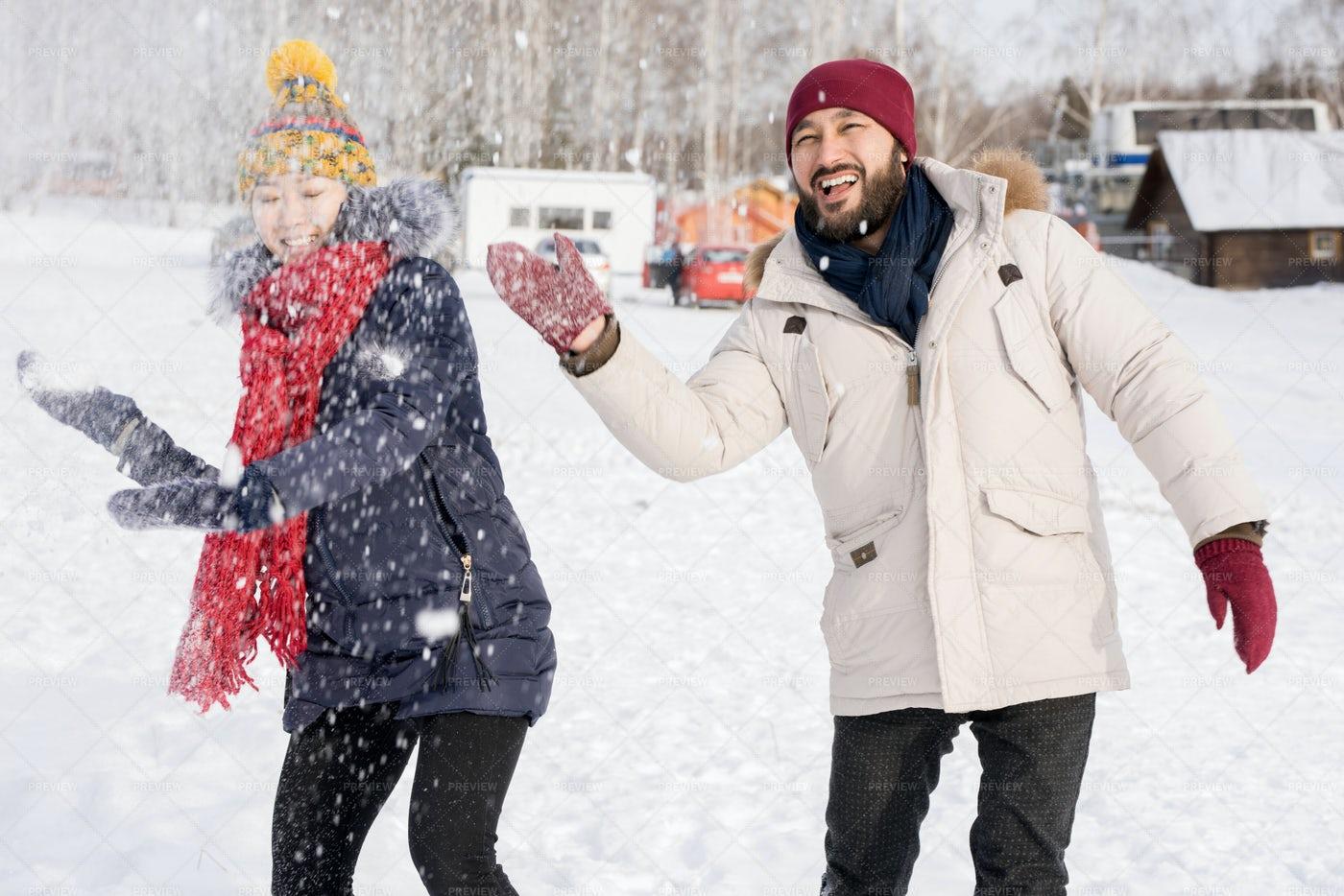 Asian Couple Having Fun In Winter: Stock Photos