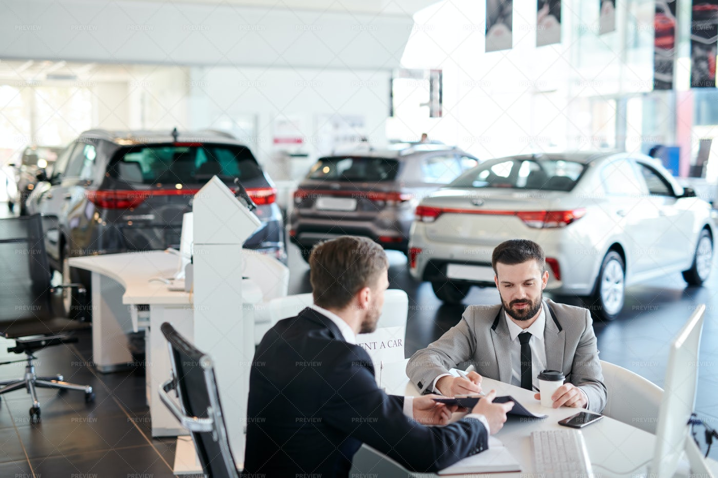 Customer Signing A Contract At Auto...: Stock Photos