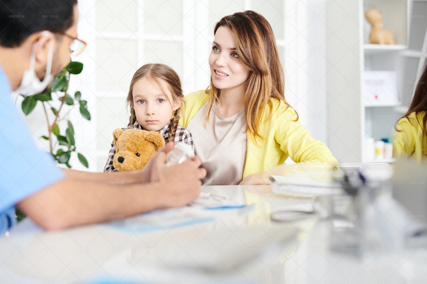 Scared Little Girl In Doctors...: Stock Photos