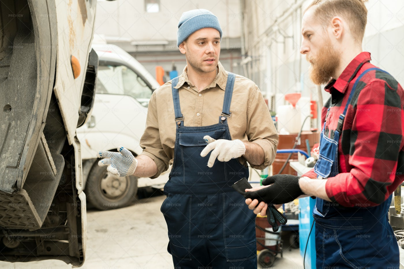 Mechanics Discussing Truck...: Stock Photos