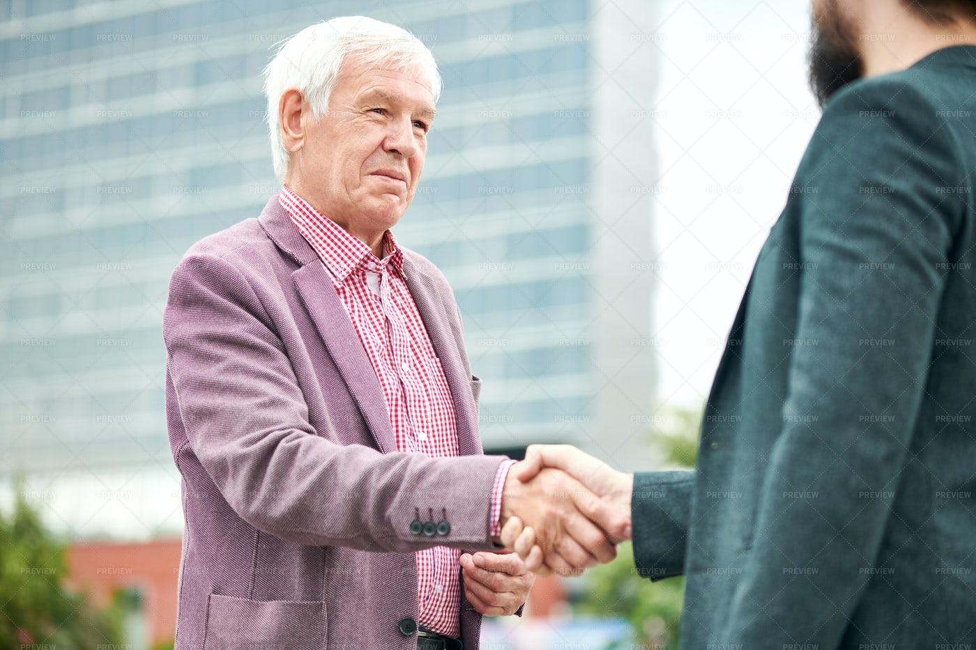 Senior Businessman Greeting Partner: Stock Photos