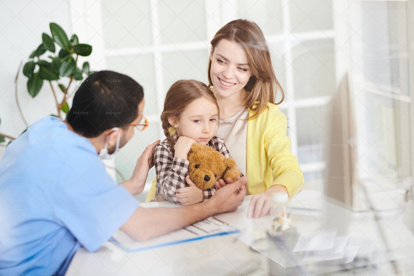 Scared Little Girl Visiting Doctor: Stock Photos