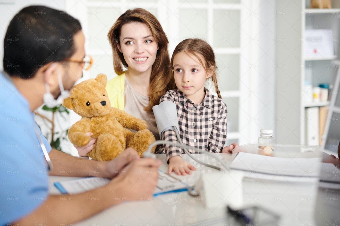 Happy Family Visiting Pediatrician: Stock Photos