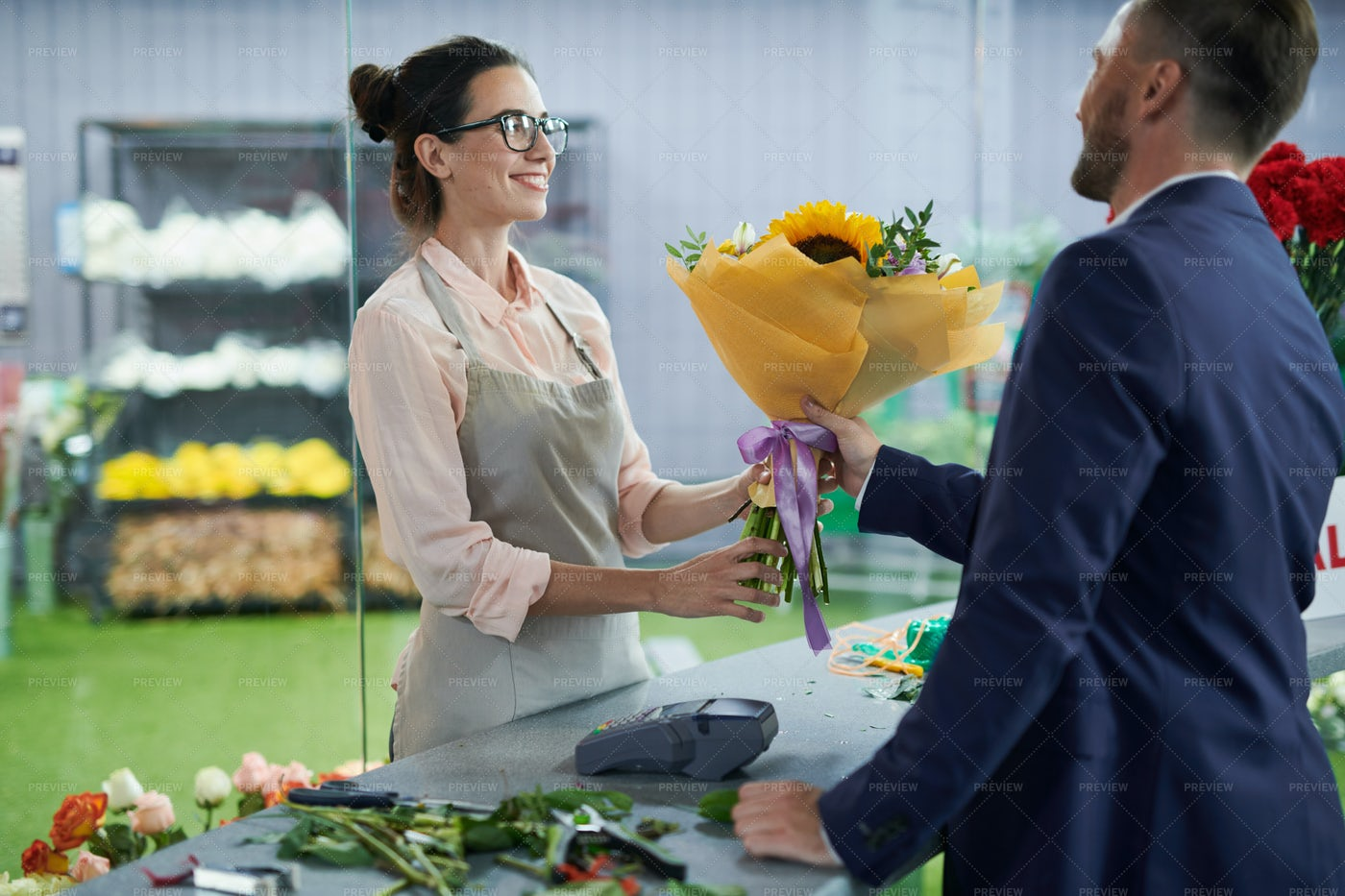 Woman Selling Flowers: Stock Photos