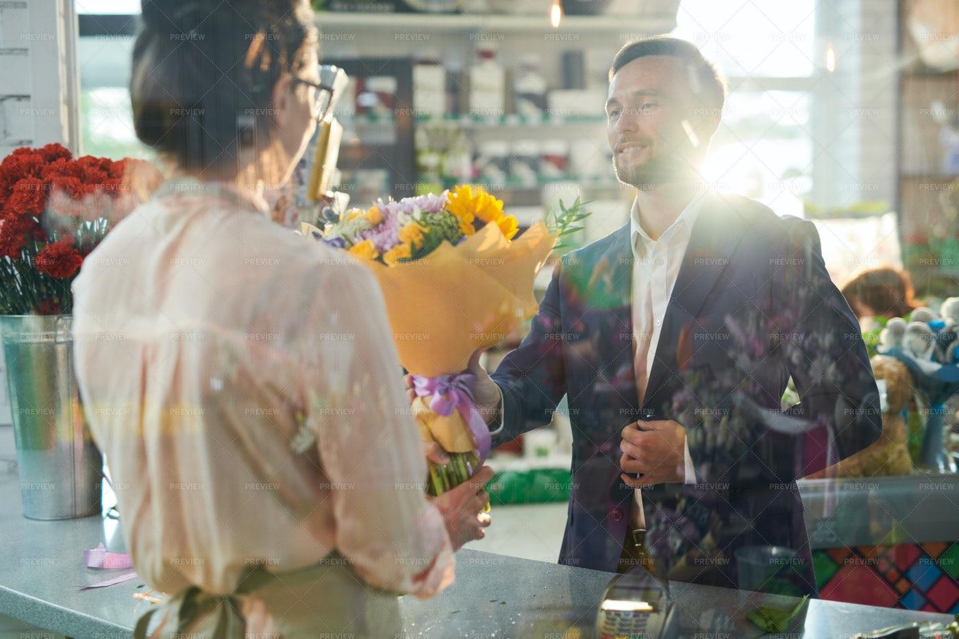 Gentleman Buying Flowers: Stock Photos