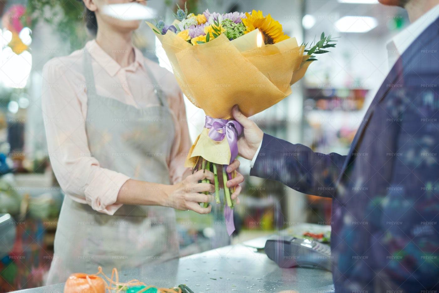 Man Buying Flowers: Stock Photos