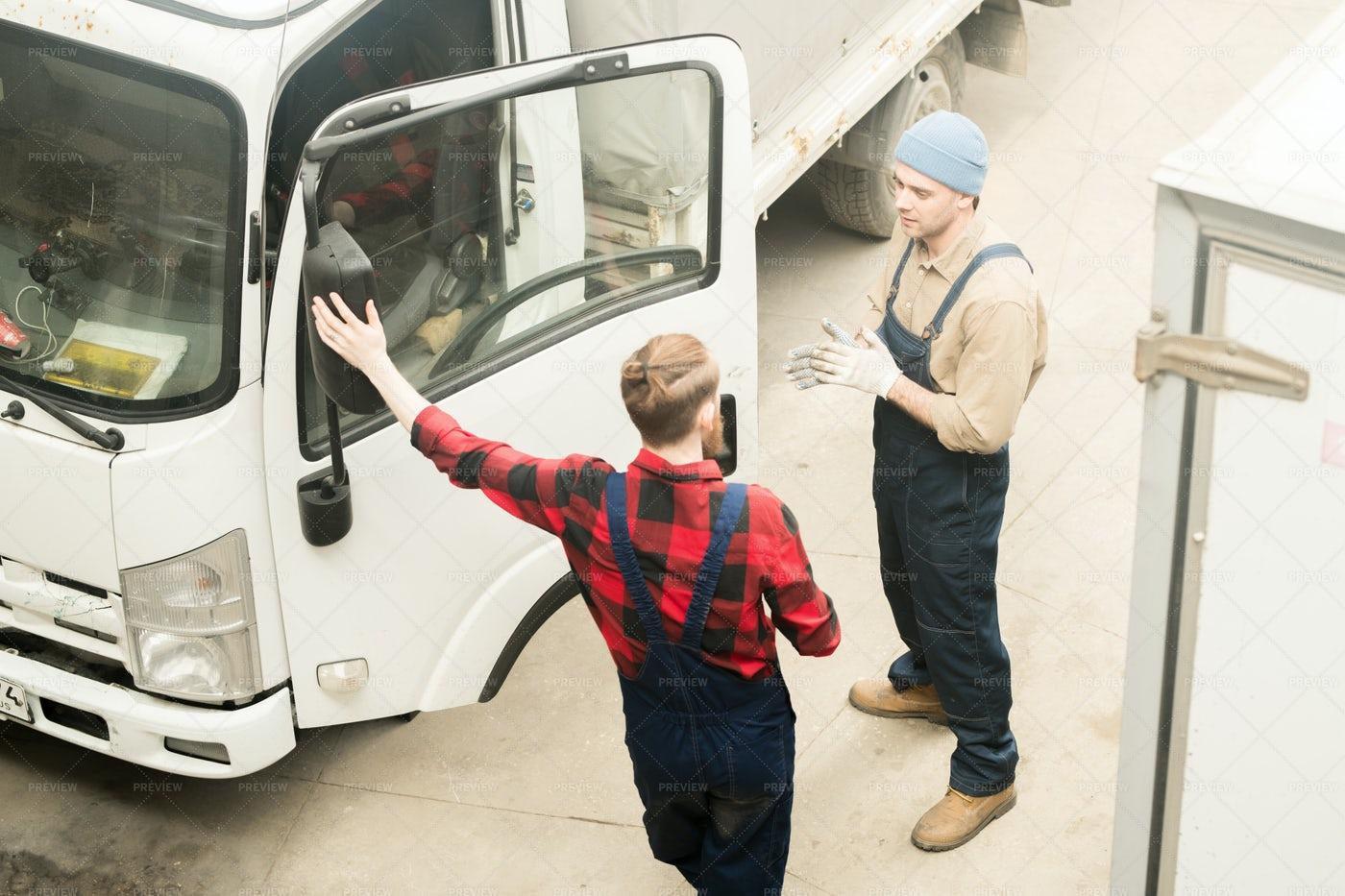 Auto Technicians Discussing Work: Stock Photos
