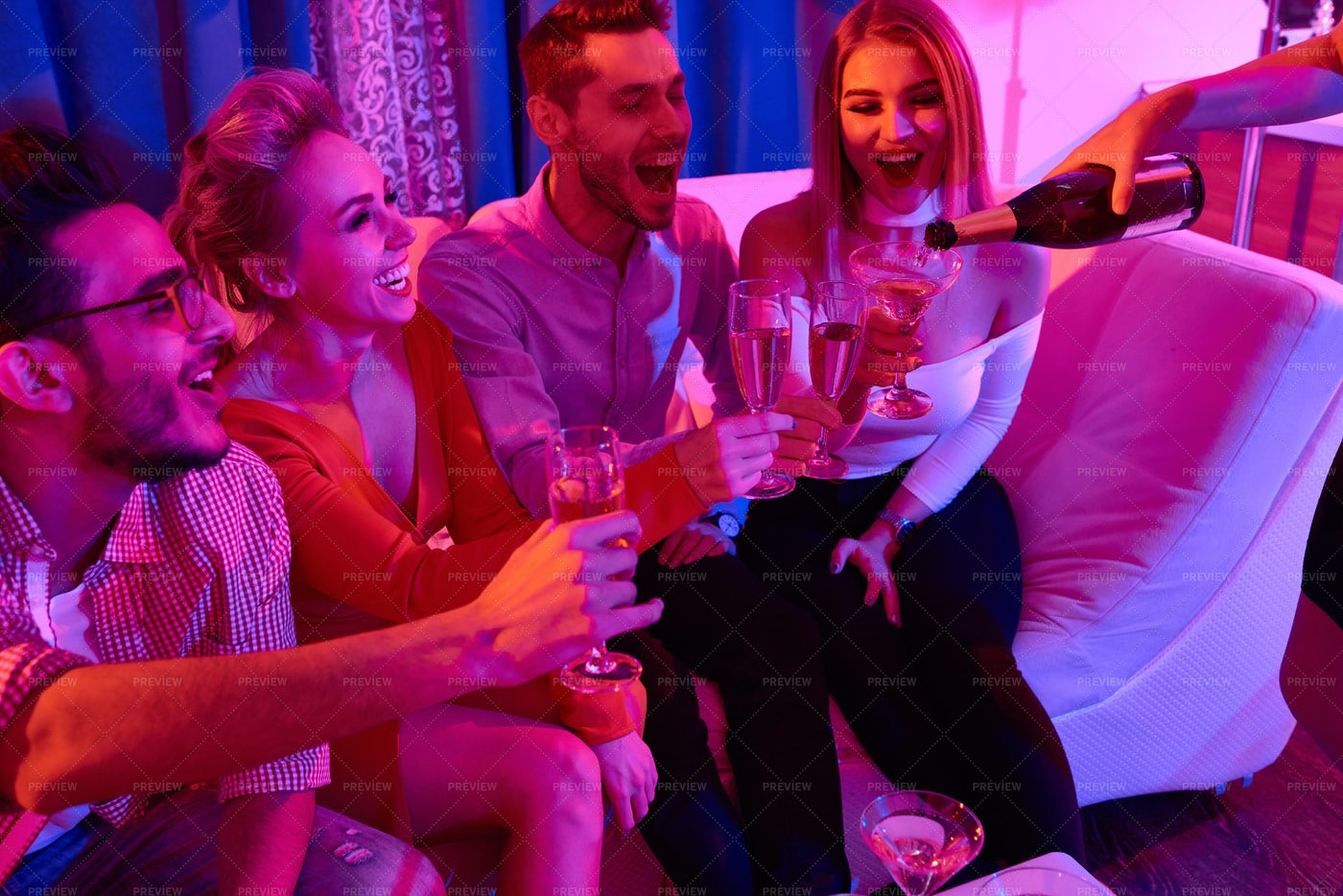 People Drinking Champagne At Party: Stock Photos