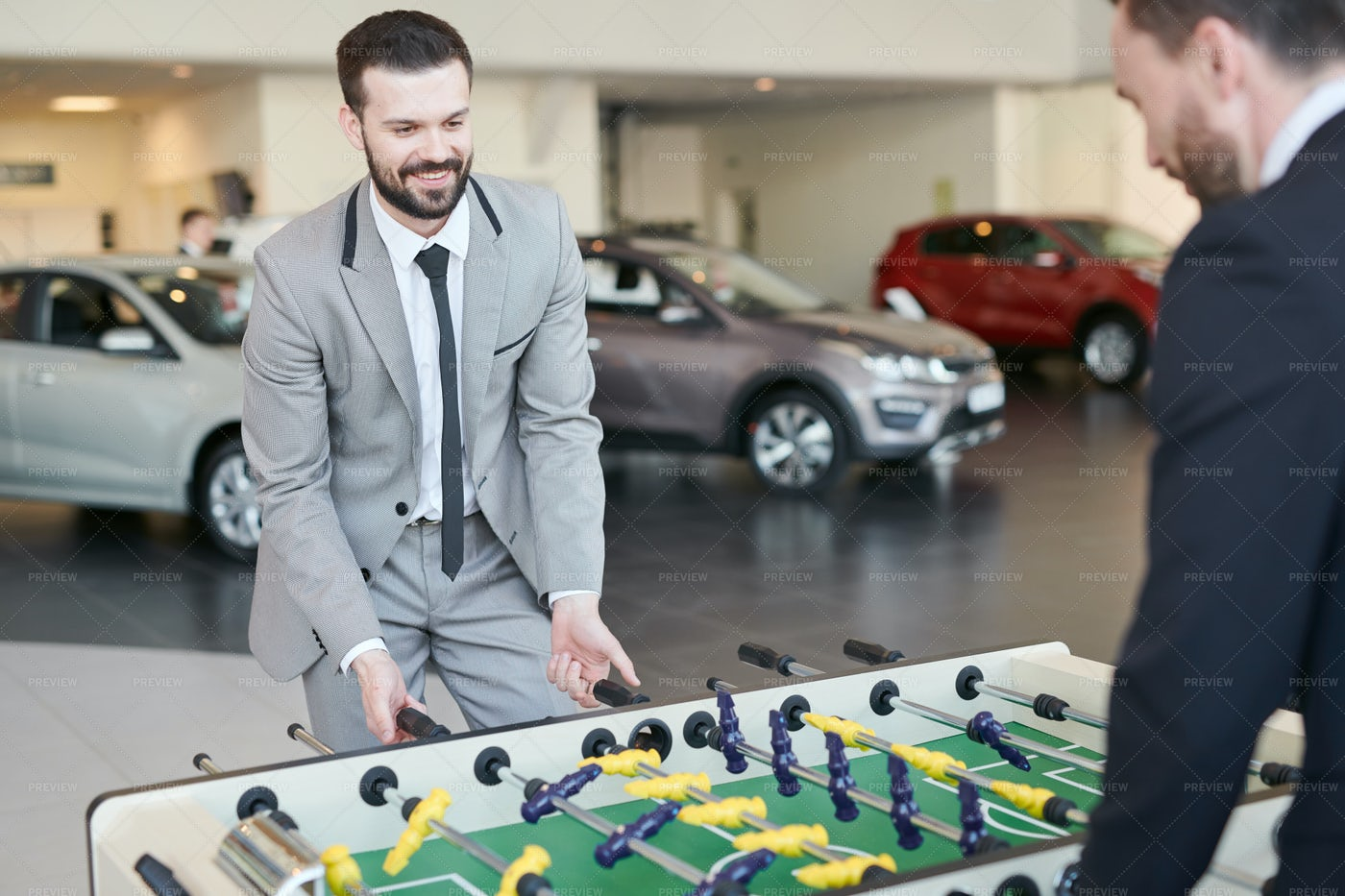 Men Playing Football Table During...: Stock Photos