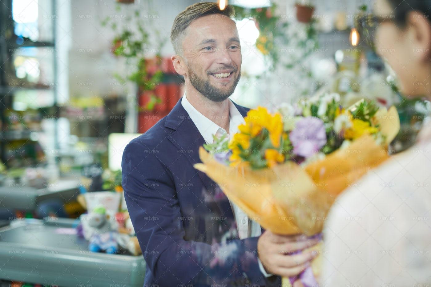 Man Buying Flower Bouquet: Stock Photos