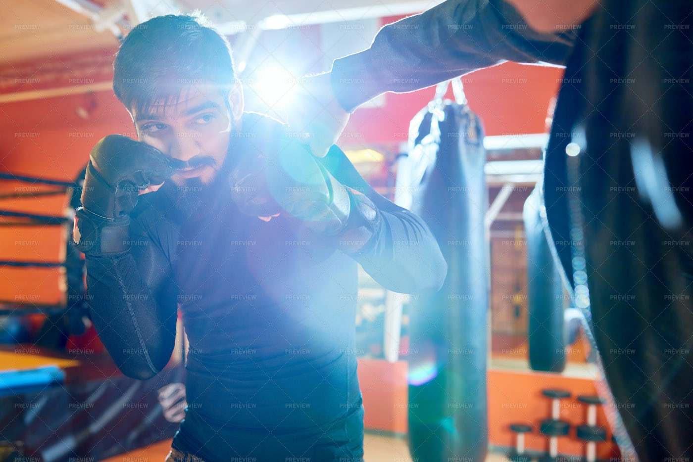 Trainer And Boxer In Sparring: Stock Photos