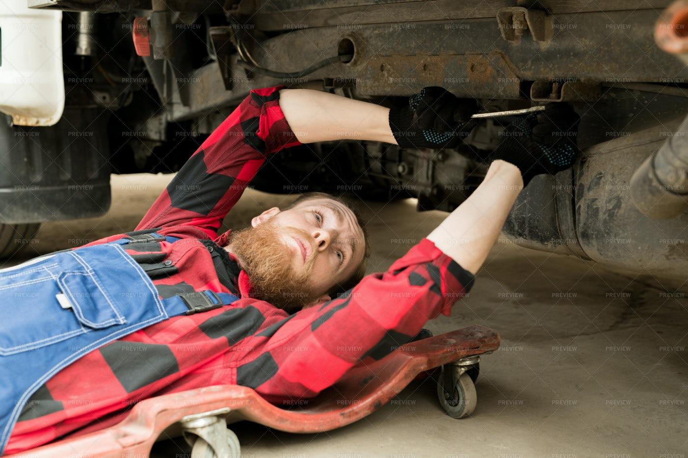 Professional Mechanic Repairing...: Stock Photos