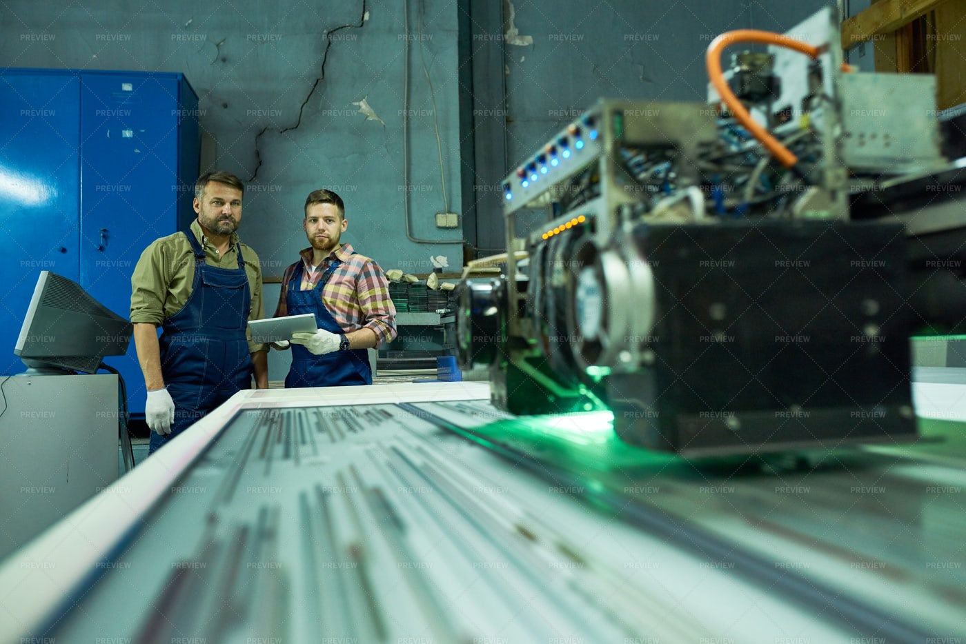 Workers Using Modern CNC Machine At...: Stock Photos