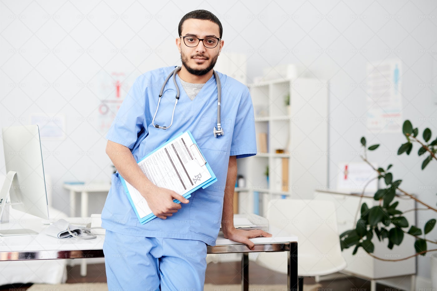 Middle-Eastern Physician Posing In...: Stock Photos