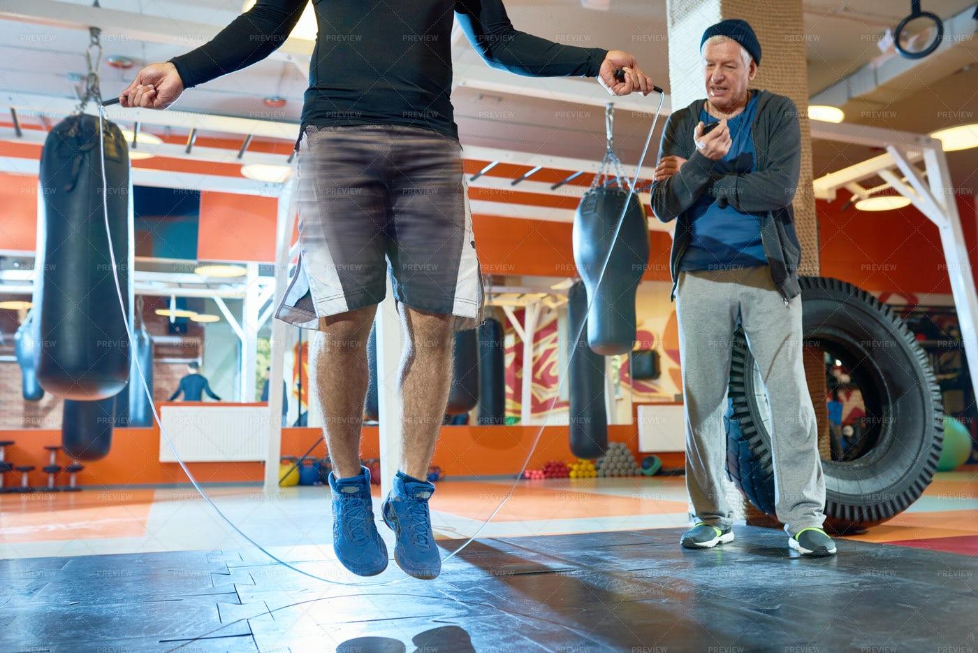Coach Training Boxer In Gym: Stock Photos