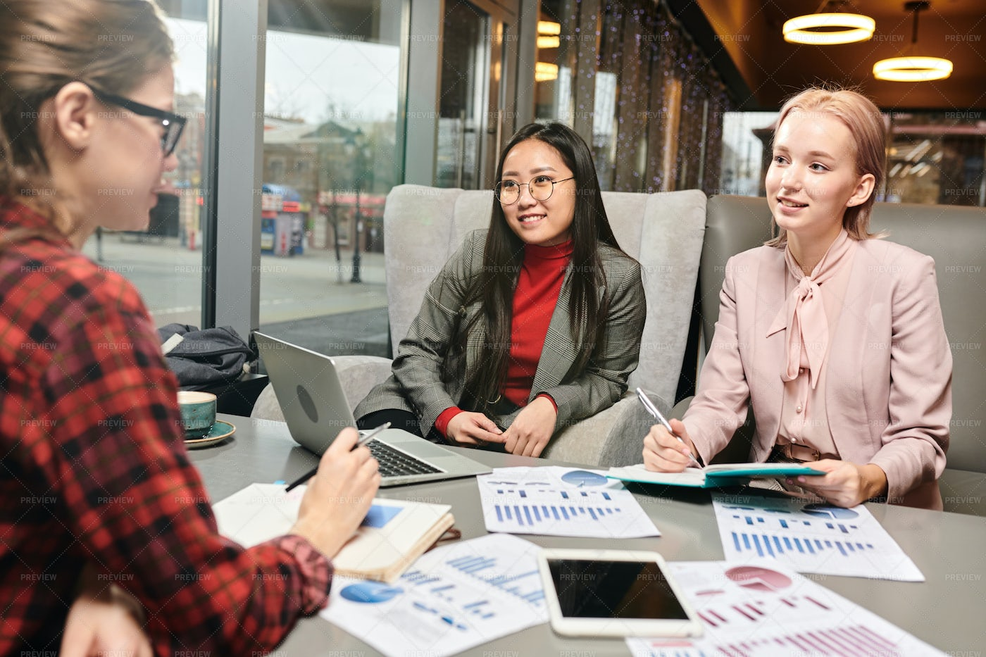 Women Have A Meeting At Cafe: Stock Photos