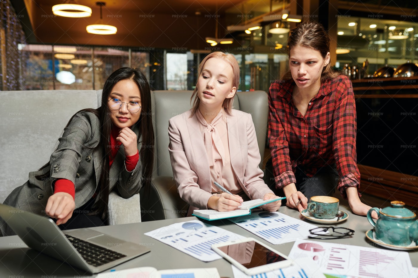 Working In Team In Cafe: Stock Photos