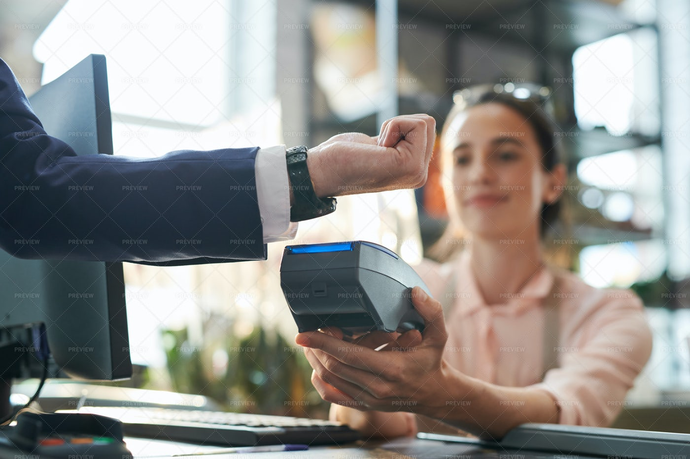 Businessman Paying By Smartwatch: Stock Photos