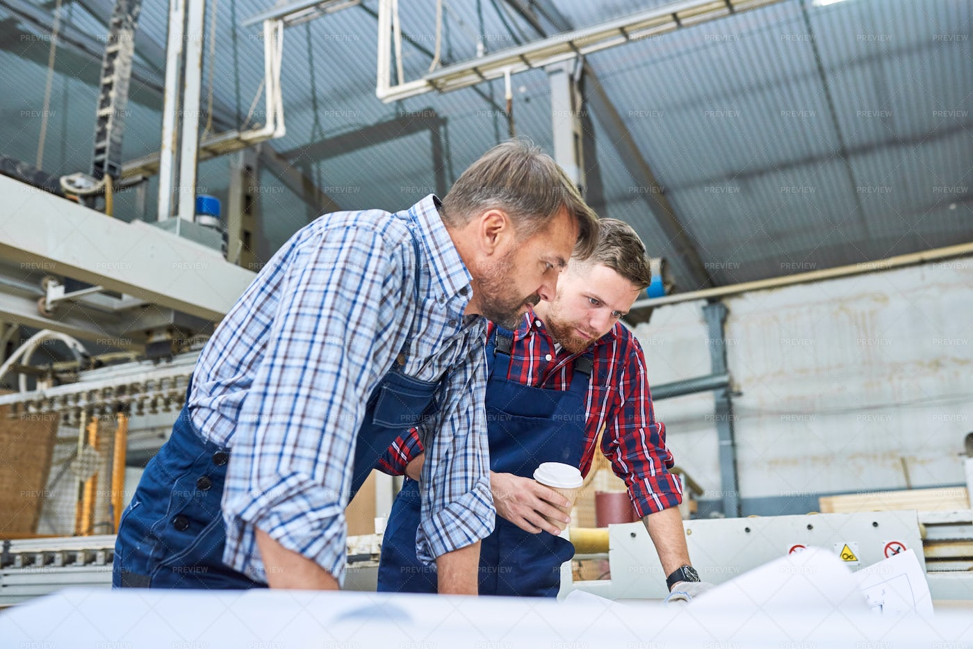 Construction Workers Discussing...: Stock Photos