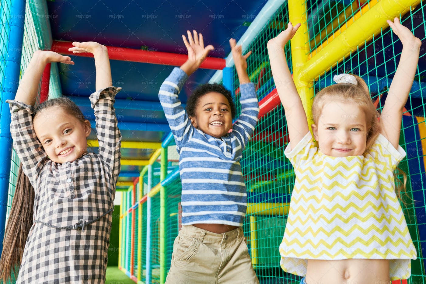 Excited Children In Play Center: Stock Photos