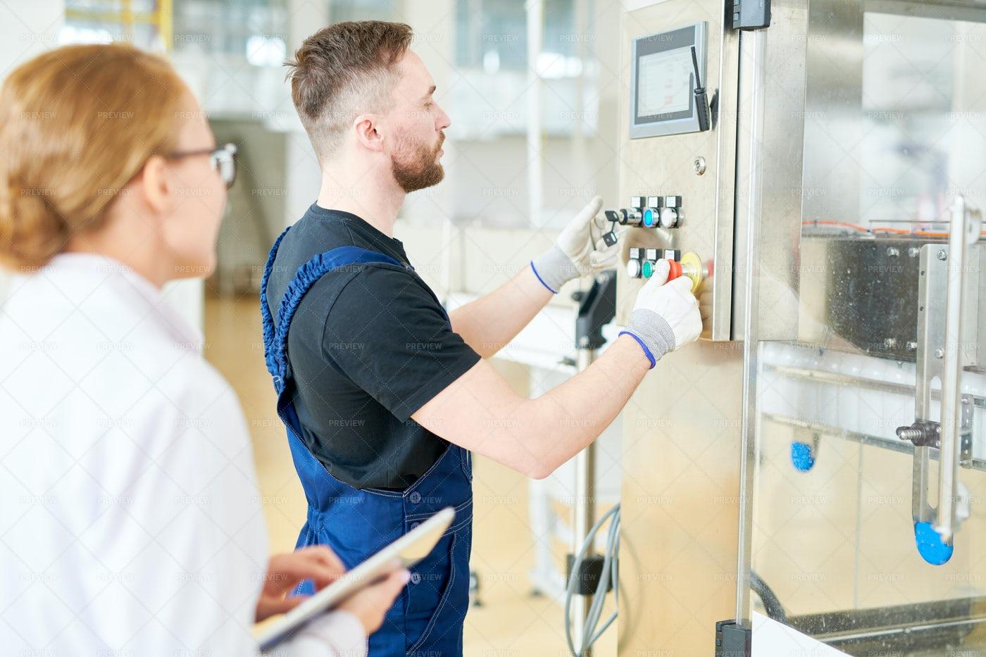 Adjusting Equipment At Dairy...: Stock Photos