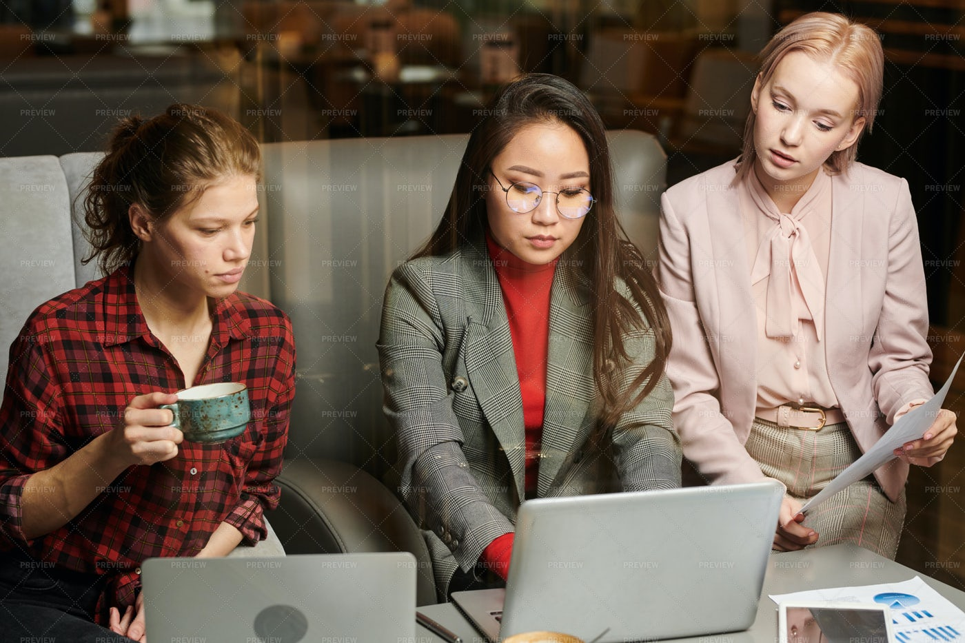 Women Working With Coursework: Stock Photos