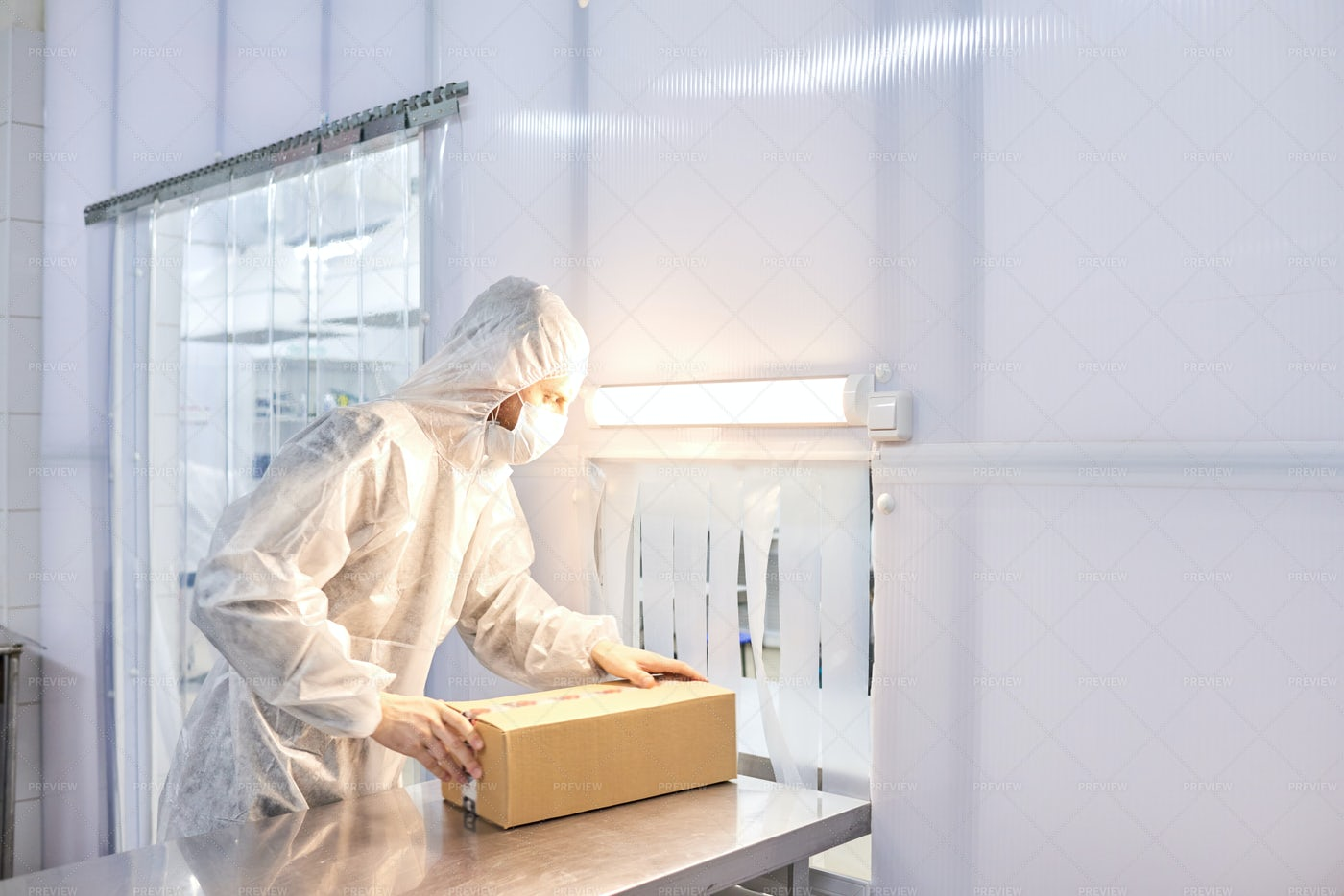 Worker Packing Medicinal Products: Stock Photos