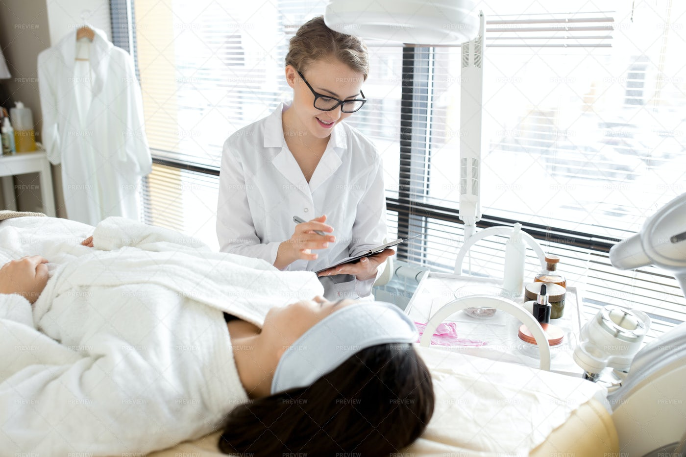 Talented Beautician Wrapped Up In...: Stock Photos