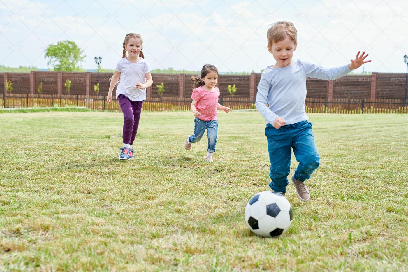 Kids Playing Football: Stock Photos